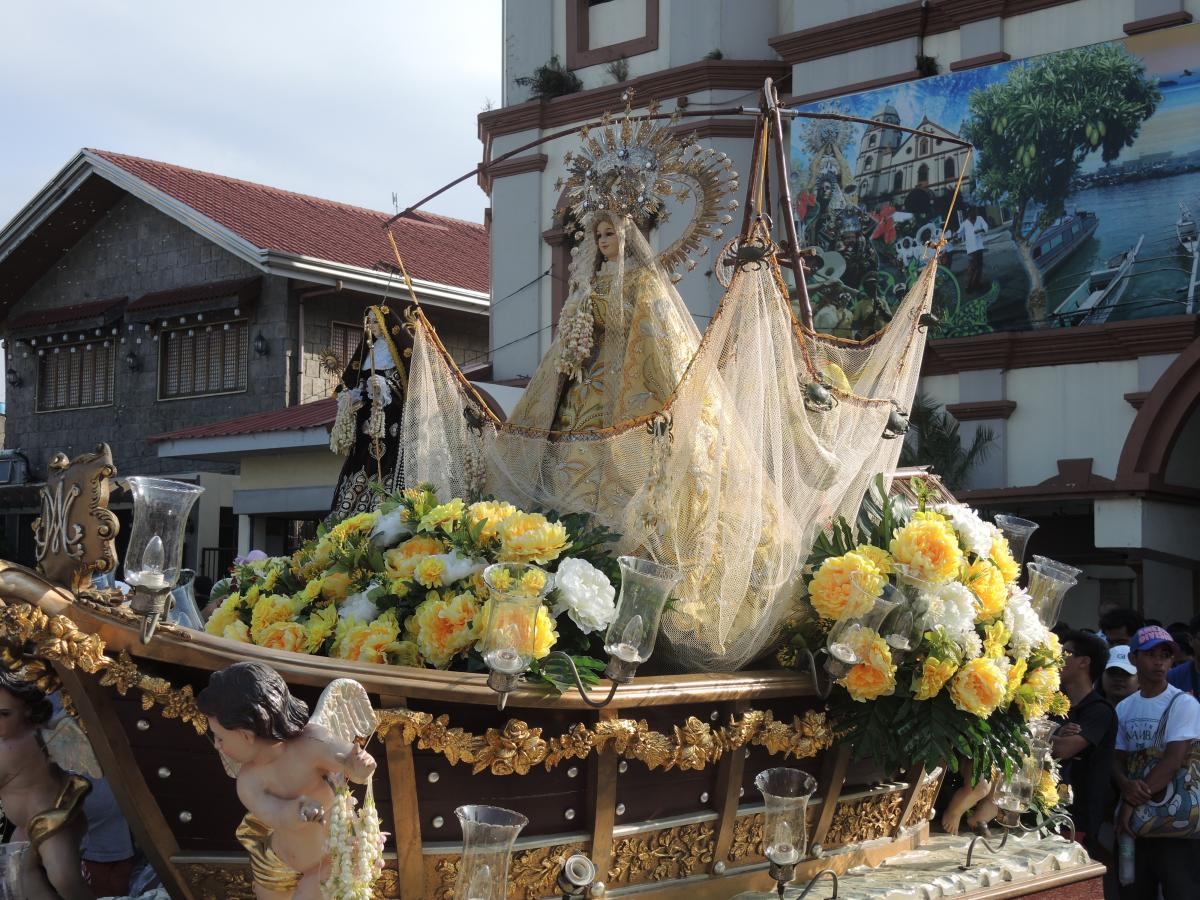 Our Lady of Salambáo, right, is patron of the third day of the feast. She is shown in a boat and a fishing net (a salambáw in Tagalog), recalling her discovery by fishermen in the sea in the 18th century.