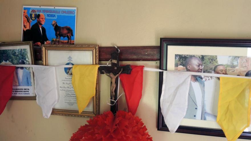 Religious and familial decorations in a family home near Jinja Karoli, Uganda.