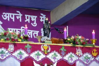 The statue of Dhori Mata, Miraculous Mother of the Coalmines, on the altar.