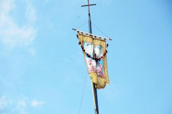 """""""Hail Mary"""" is written in Hindi on the flag that flies over the feast of Dhori Mata."""