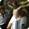 Members of the Hermandad in Izalco, El Salvador, prepare the image of Christ with a cross made with Corozo palms, on the morning of Holy Thursday. The image will be carried in the Procesion de los Cristos. Photo credit: Josue Parada/El Salvador
